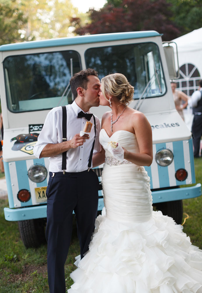 Elegant bride and groom with popsicles in front of a food truck at their Prallsville Mills wedding in Stockton, NJ photographed by Laura Billingham