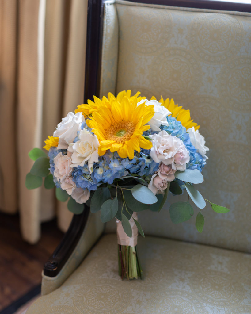 Beautiful bridal bouquet of sunflowers photographed in the bridal suite at the Molly Pitcher Inn in Red Bank, NJ by Laura Billingham