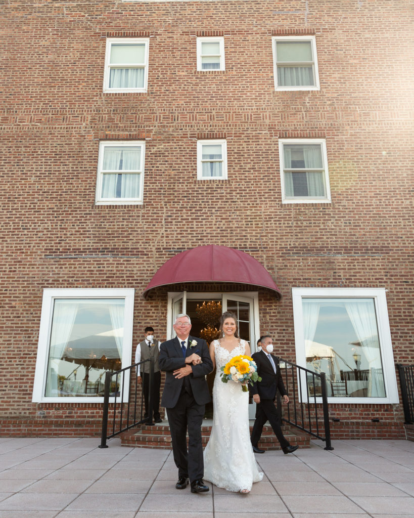 Father of the bride and bride entrance at the Molly Pitcher Inn in Red Bank, NJ photographed by Laura Billingham