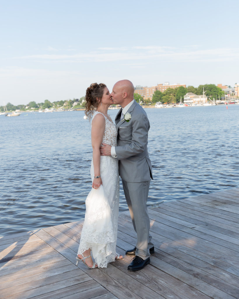 Elegant bride and groom on the Marina at the Molly Pitcher Inn in Red Bank, NJ by wedding photographer Laura Billingham