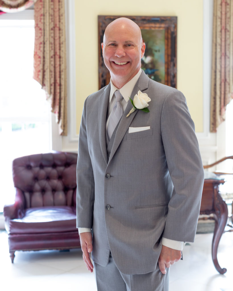 Elegant groom portrait in the lobby at Molly Pitcher Inn in Red Bank, NJ photographed by Laura Billingham Photography