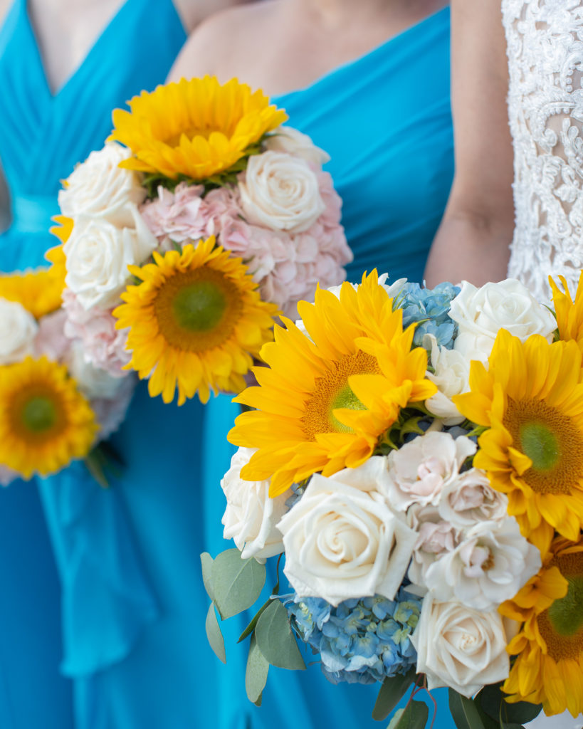 Colorful sunflower bridal bouquets at the Molly Pitcher Inn in Red Bank, NJ photographed by Laura Billingham