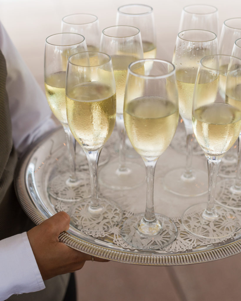 Tray of champagne awaits wedding reception guests at the Molly Pitcher Inn in Red Bank, NJ photographed by Laura Billingham