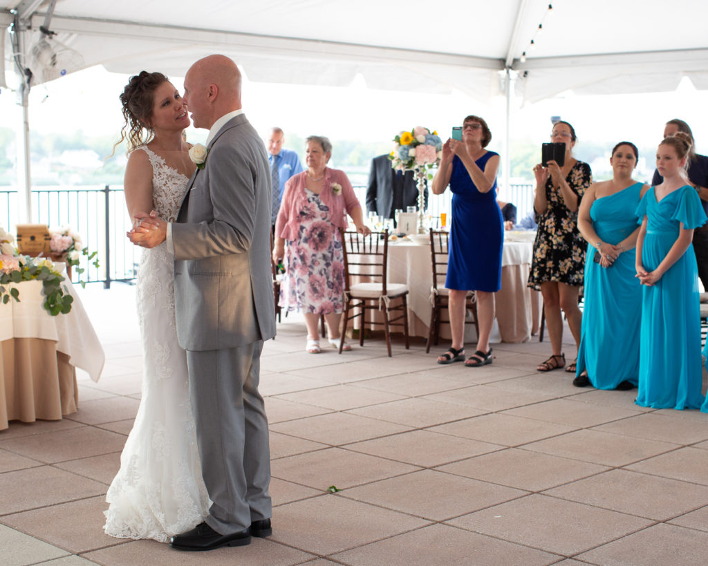 Elegant bride and groom enjoy their first dance under the reception tent at the Molly Pitcher Inn in Red Bank, NJ photographed by Laura Billingham