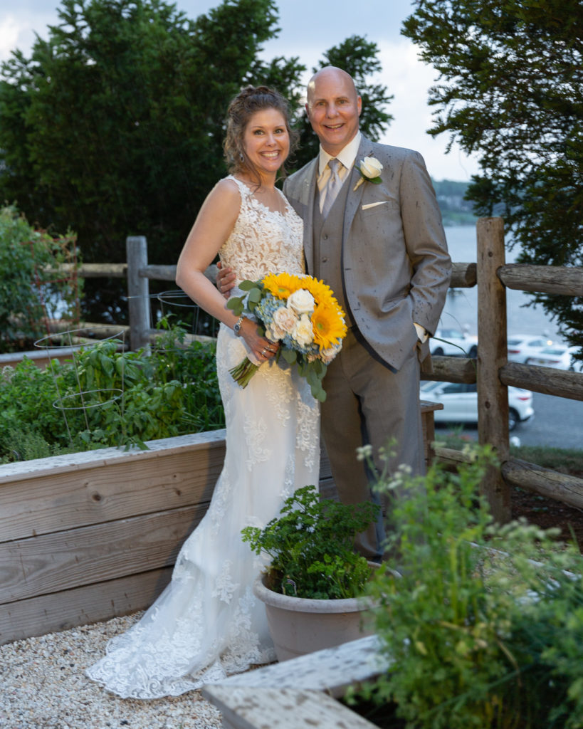 Elegant bridal portrait in front of the Molly Pitcher Inn in Red Bank, NJ by wedding photographer Laura Billingham