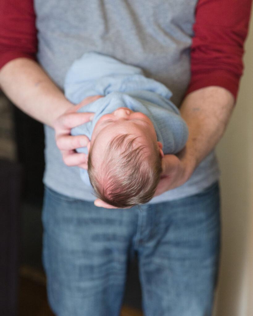 Dad holding a newborn in Somerville, NJ