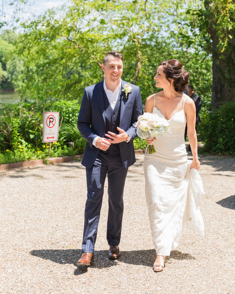 An elegant bride and groom walking after their wedding ceremony by Bridgeton House on the Delaware photographed by Laura Billingham Photography
