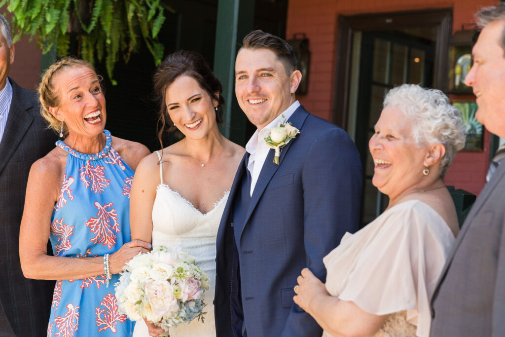 Candid family portrait with elegant bridge and groom at Bridgeton House on the Delaware by Laura Billingham Photography