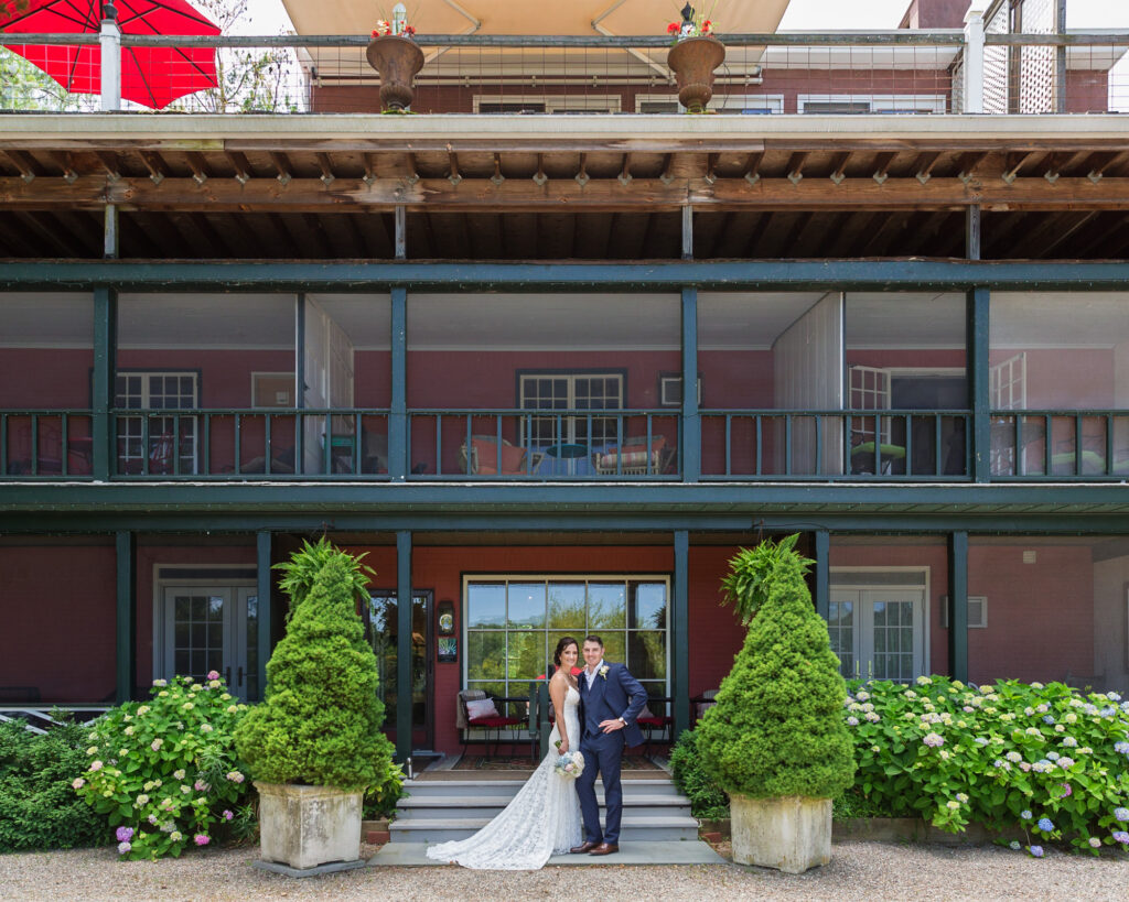 elegant portrait of a bride and groom in front of Bridgeton House on the Delaware photo by Laura Billingham Photography