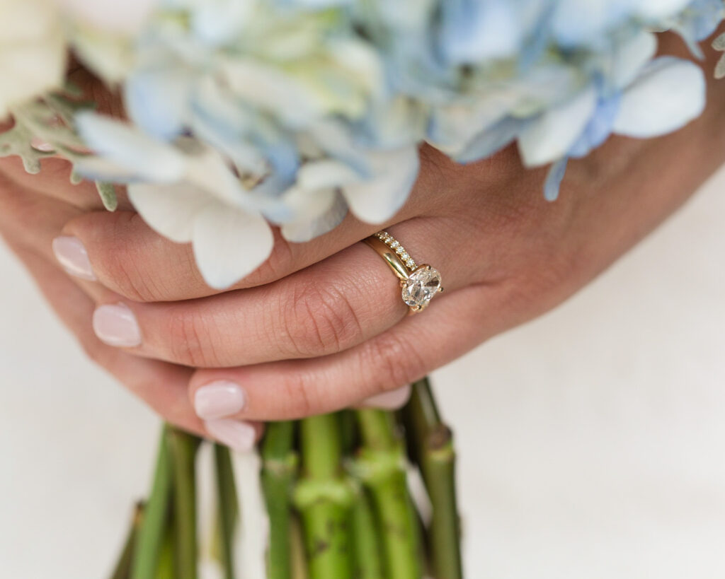 Detail of an elegant summer bridal bouquet and bride's hands with wedding rings at Bridgeton House on the Delaware by Laura Billingham Photography