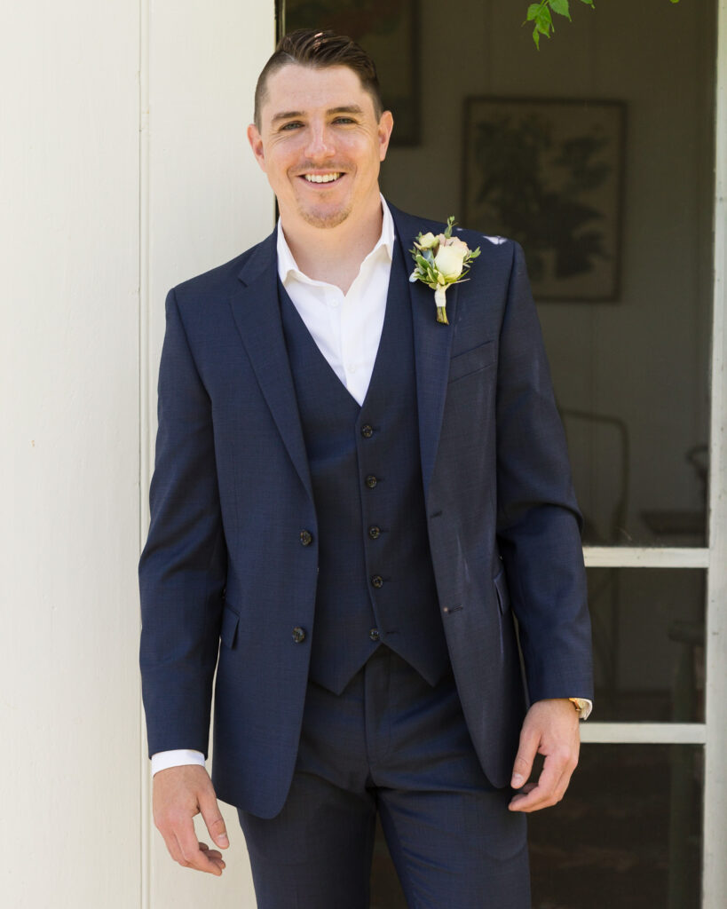 Elegant groom at Bridgeton House on the Delaware photographed by Laura Billingham