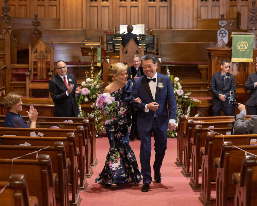 elegant bride and groom walking down the aisle after saying their vows at the Flemington Presbyterian Church in Flemington, NJ by Laura Billingham Photography