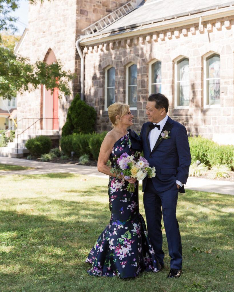 Full length portrait of an elegant bride  and groom after their wedding ceremony at Flemington Presbyterian Church in Flemington, NJ by Laura Billingham Photography
