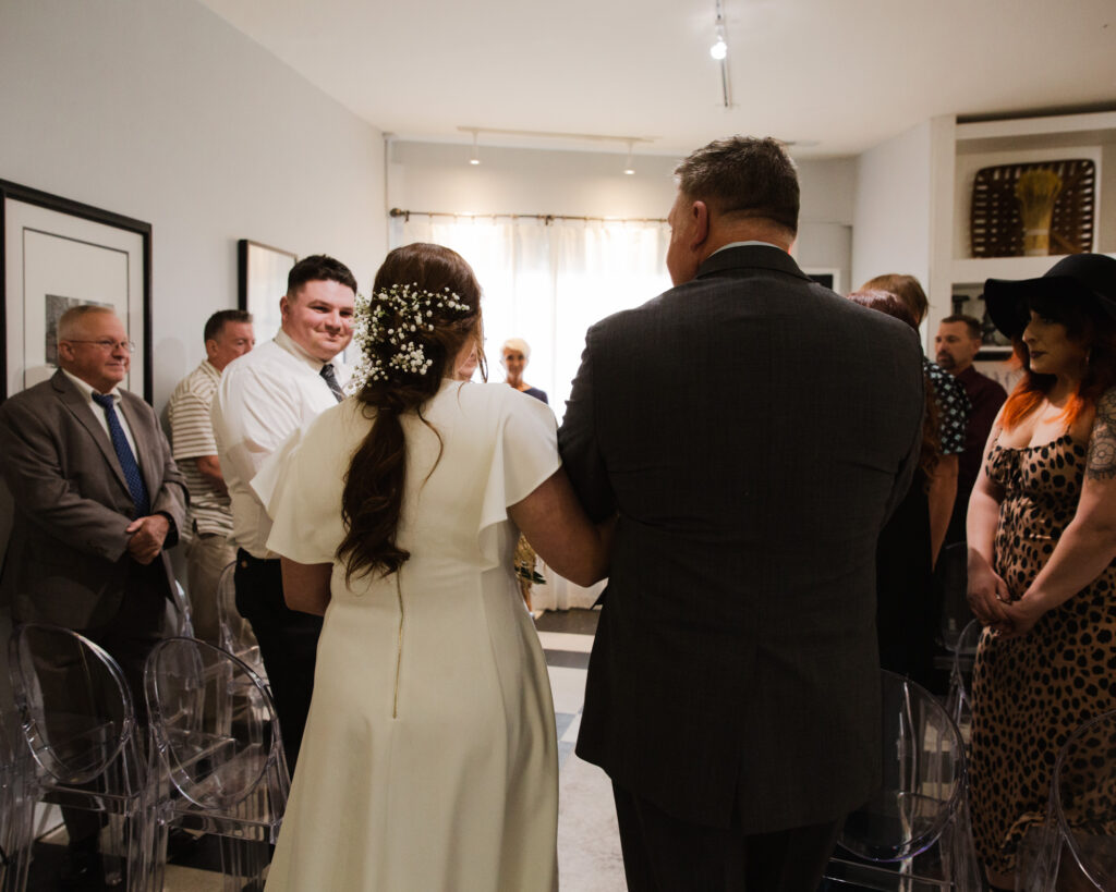 Father of the bride walks bride to the altar before a micro wedding ceremony at 15 Landsdowne in Frenchtown, NJ photographed by Laura Billingham