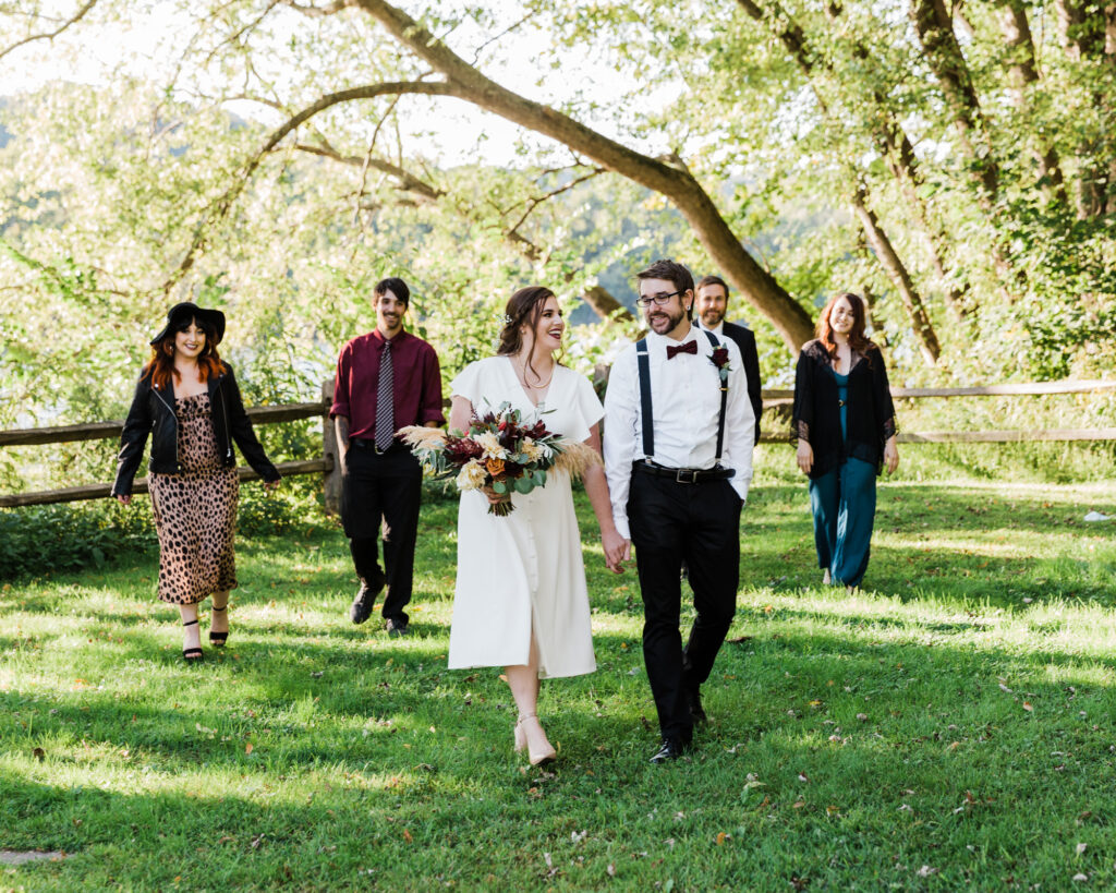 Wedding party walks in Sunbeam Park after bride and groom's micro wedding ceremony at 15 Landsdowne in Frenchtown, NJ photographed by Laura Billingham