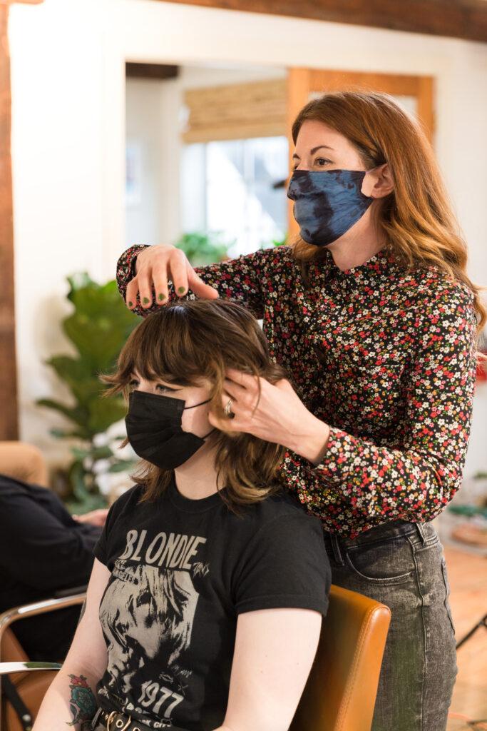 branding photography of luxury hair salon stylist at work