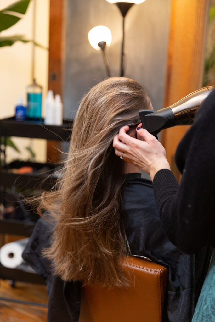 branding photography of luxury hair salon stylist at work