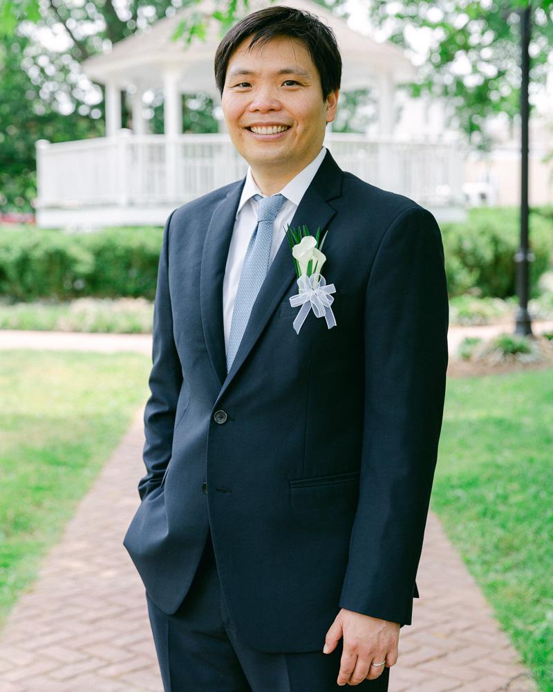 Elegant groom poses for a portrait after his Flemington, NJ elopement ceremony