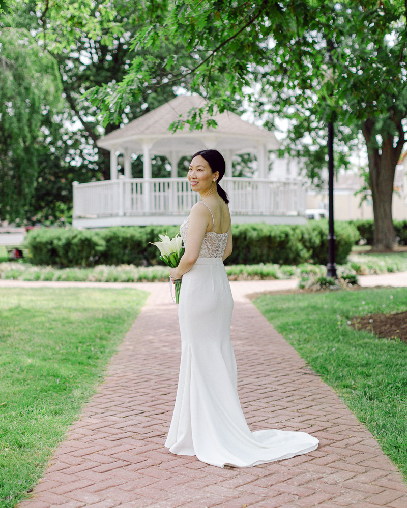 Elegant bride in a modern sheath dress poses for a full length portrait after her Flemington NJ elopement