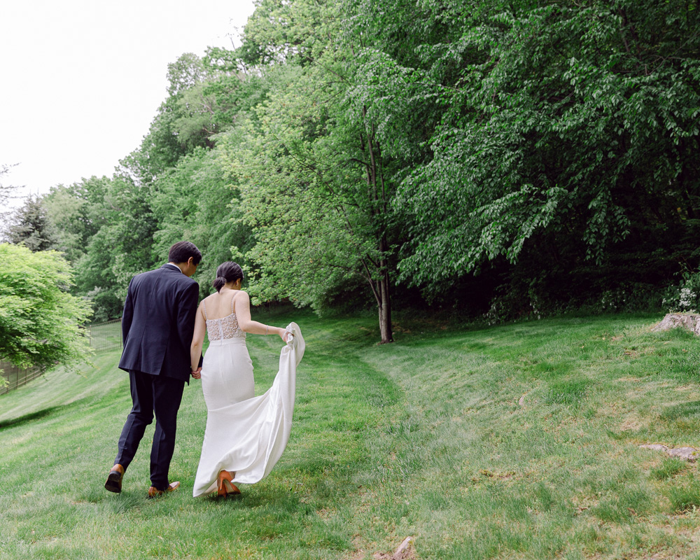 An elegant bride and groom walk away from after their elegant elopement in Flemington NJ photographed by Laura Billingham
