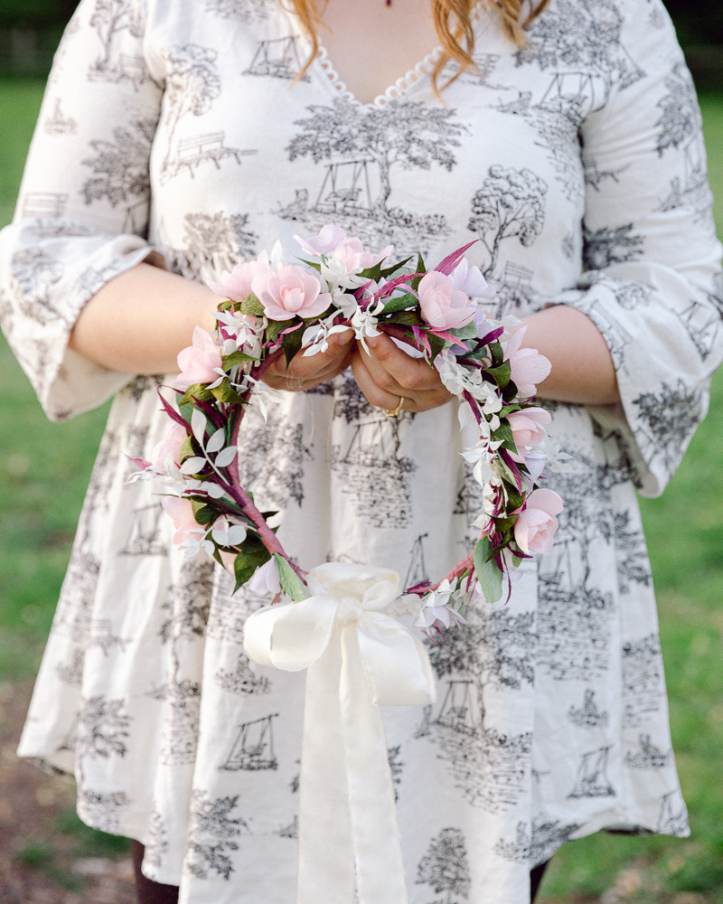 Detail of a bohemian bride with flower crown near the Delaware River in Frenchotwn NJ