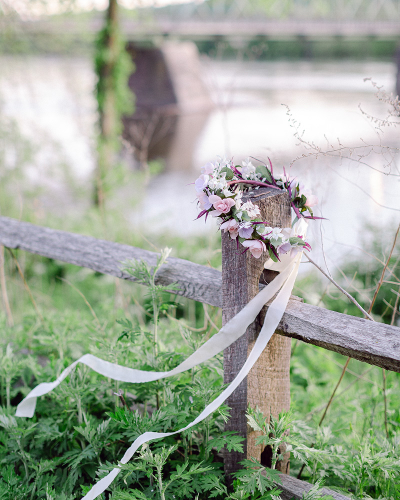 flower crown rests on a fence near the Delaware River in Frenchotwn NJ