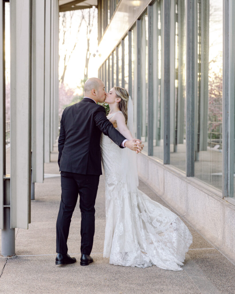 Elegant bride and groom kiss at sunset in Bethlehem, PA by Laura Billingham Photography