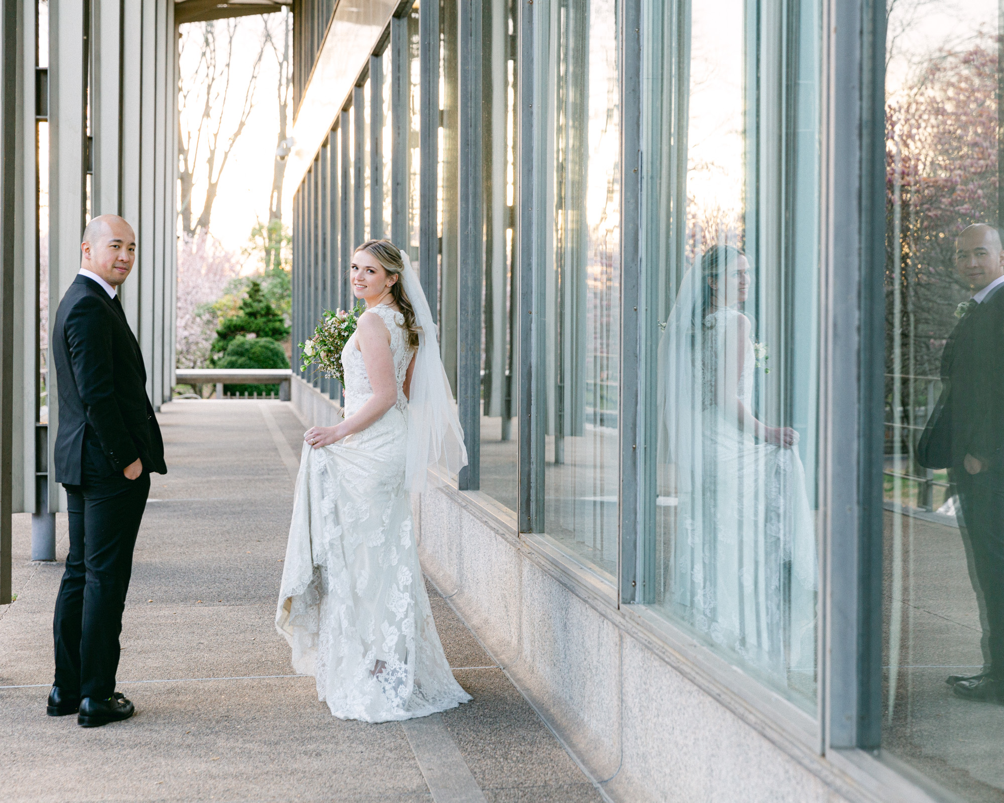 Elegant bride and groom look back over the shoulders at sunset at the Bethlehem Area Public Library in Bethlehem, PA by Laura Billingham Photography