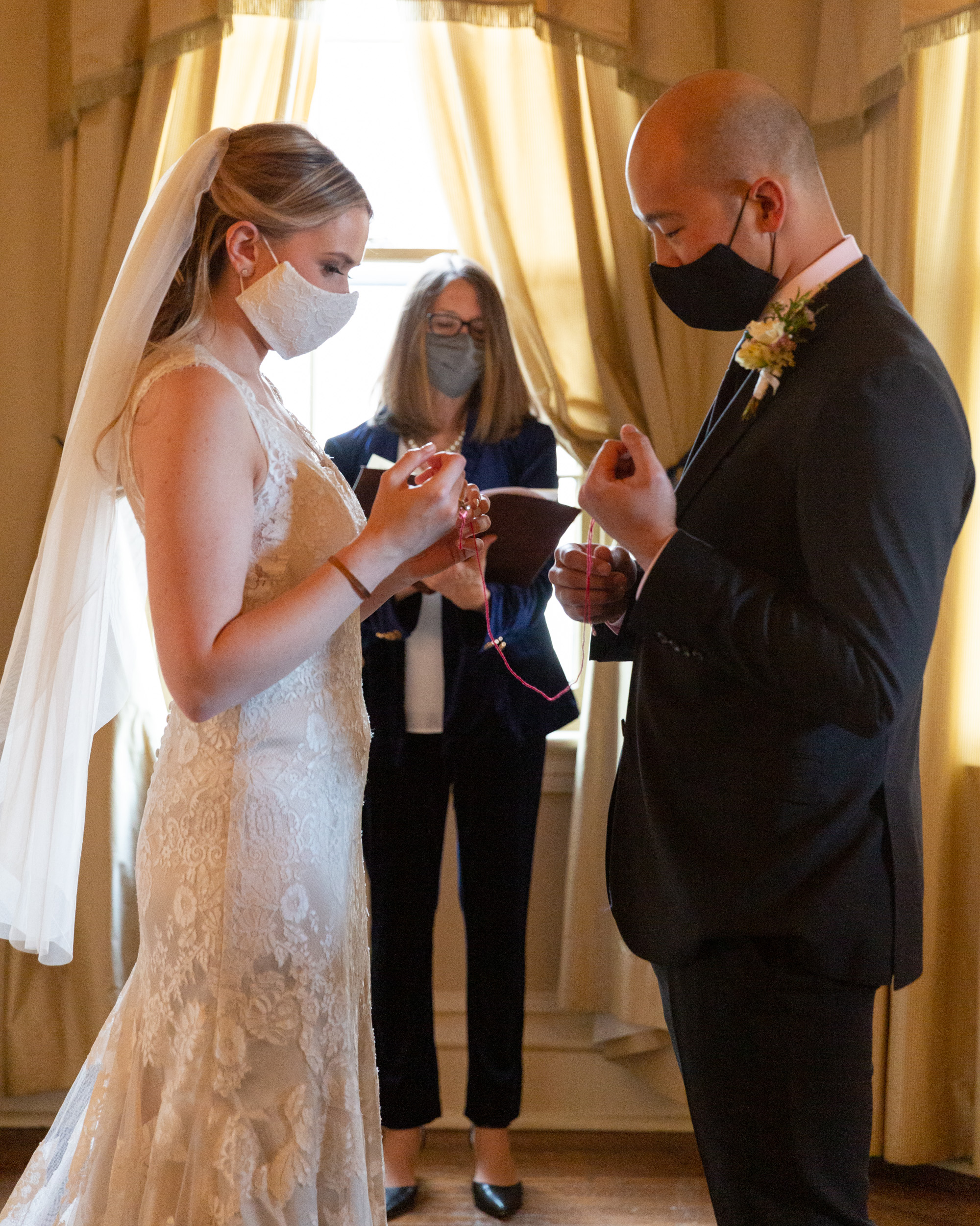 Elegant bride and groom say their vows in the Sayre Mansion in Bethlehem, PA by Laura Billingham Photography