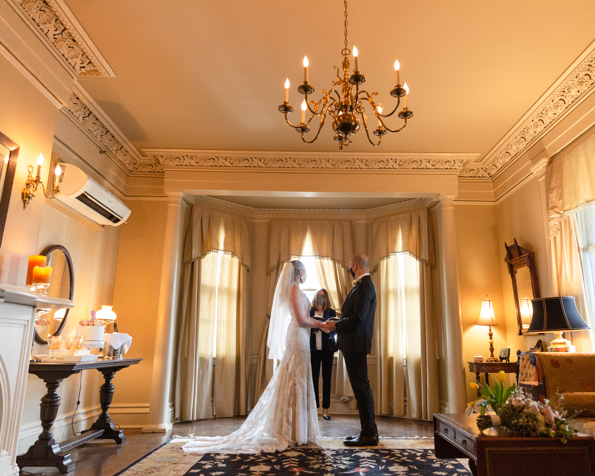 Bride and groom say their vows in the elegant historic Sayre Mansion during their wedding ceremony in Bethlehem, PA by Laura Billingham Photography