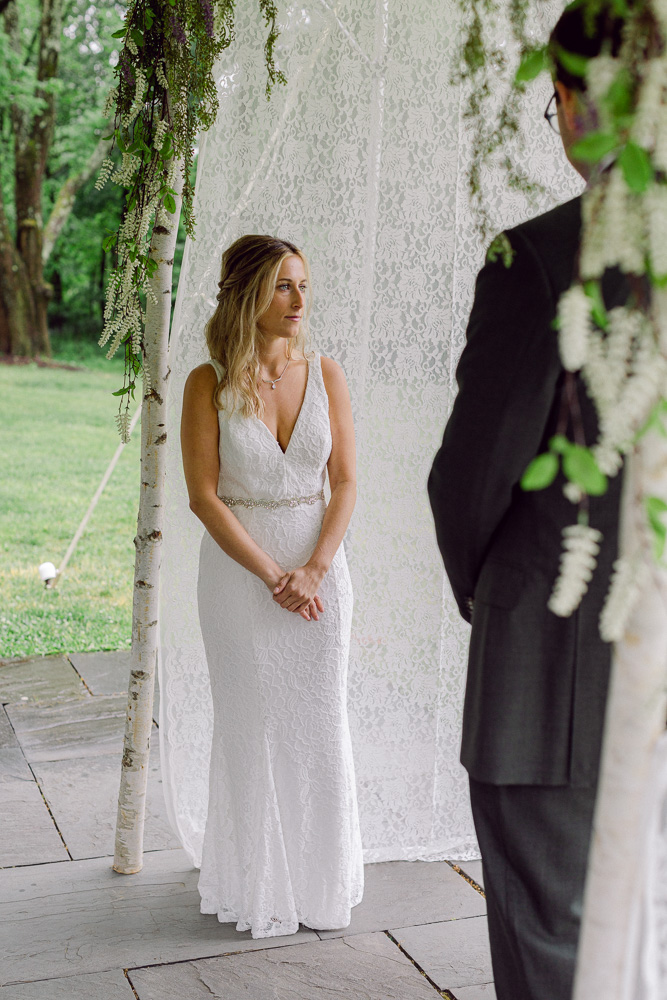 bride during her wedding ceremony at Mountain Lakes House in Princeton NJ by Laura Billingham Photography