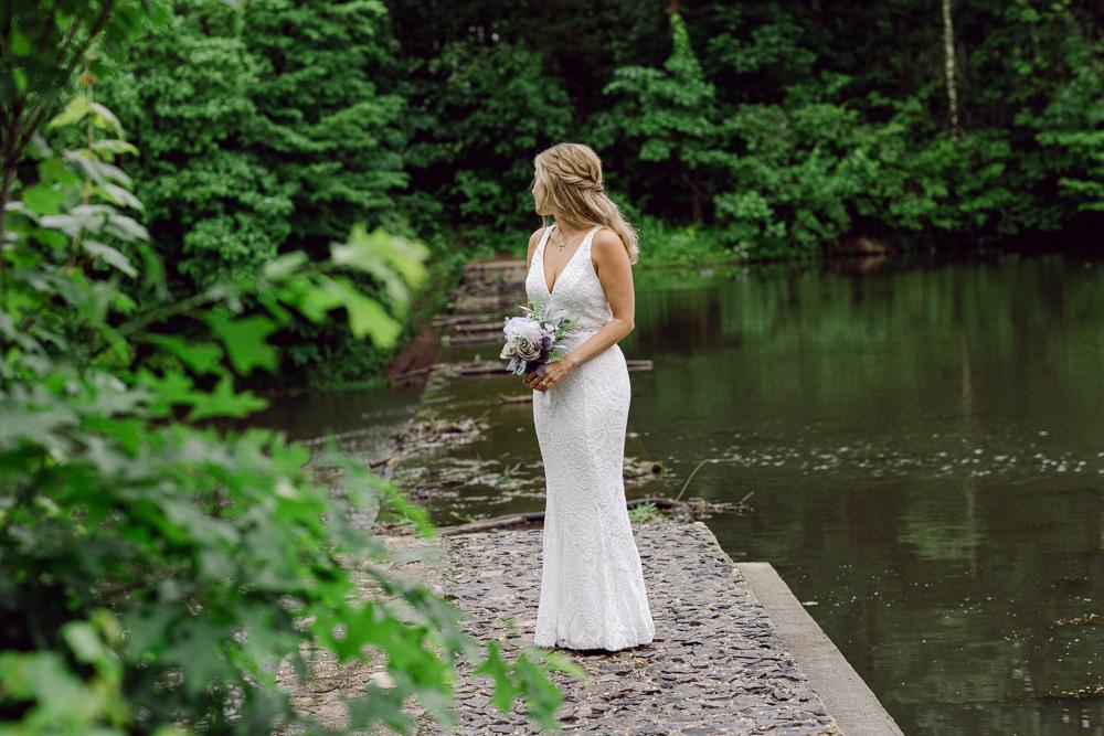 Portrait of an elegant bride at the lake at Mountain Lakes House in Princeton NJ