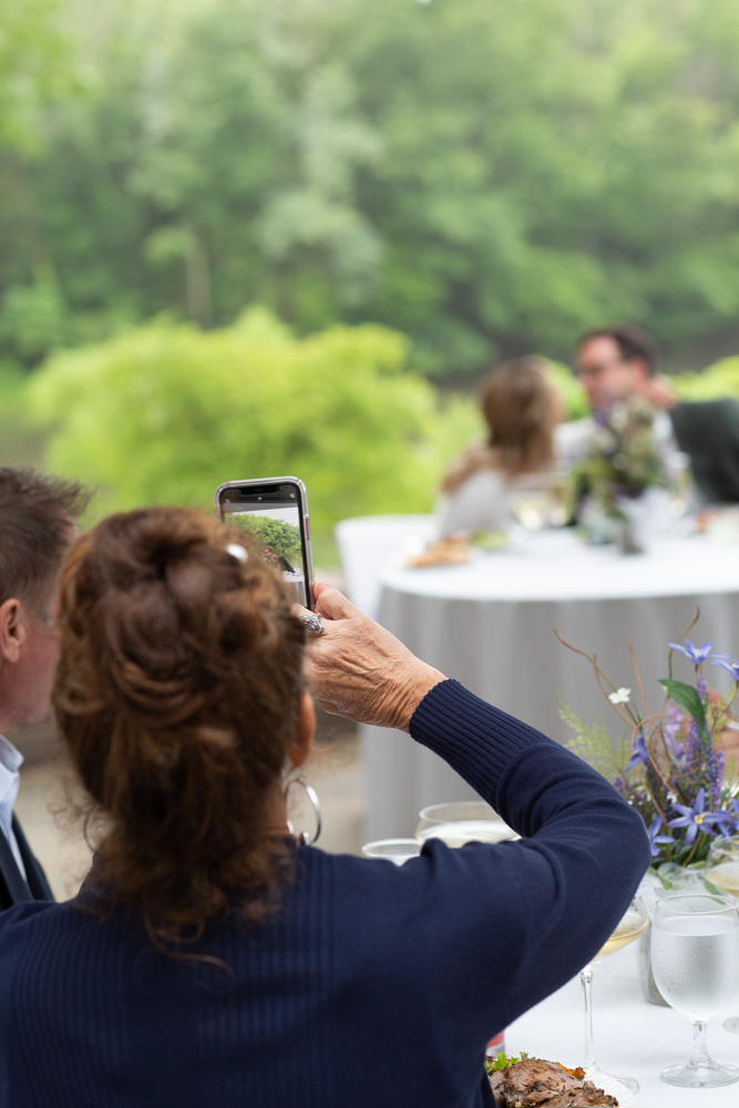 A bride and groom kiss during their wedding reception at Mountain Lakes House in Princeton NJ by Laura Billingham Photography