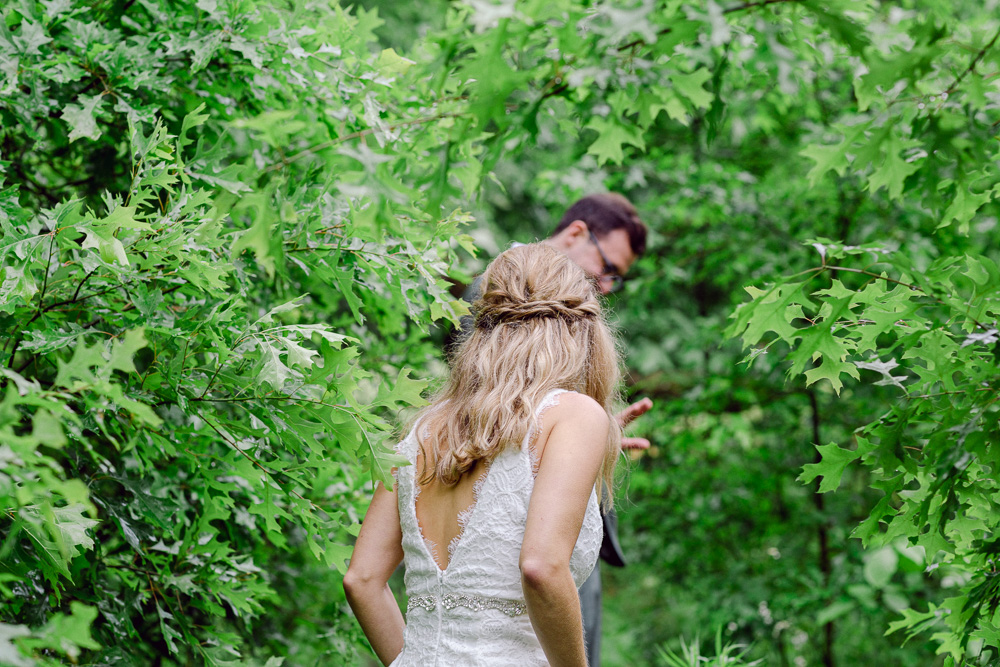 A bride walks through the woods at Mountain Lakes House in Princeton NJ by Laura Billingham Photography