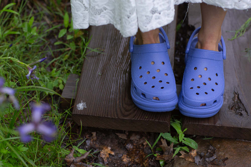 A detail of blue Crocs worn by a bride at Mountain Lakes House in Princeton NJ by Laura Billingham Photography