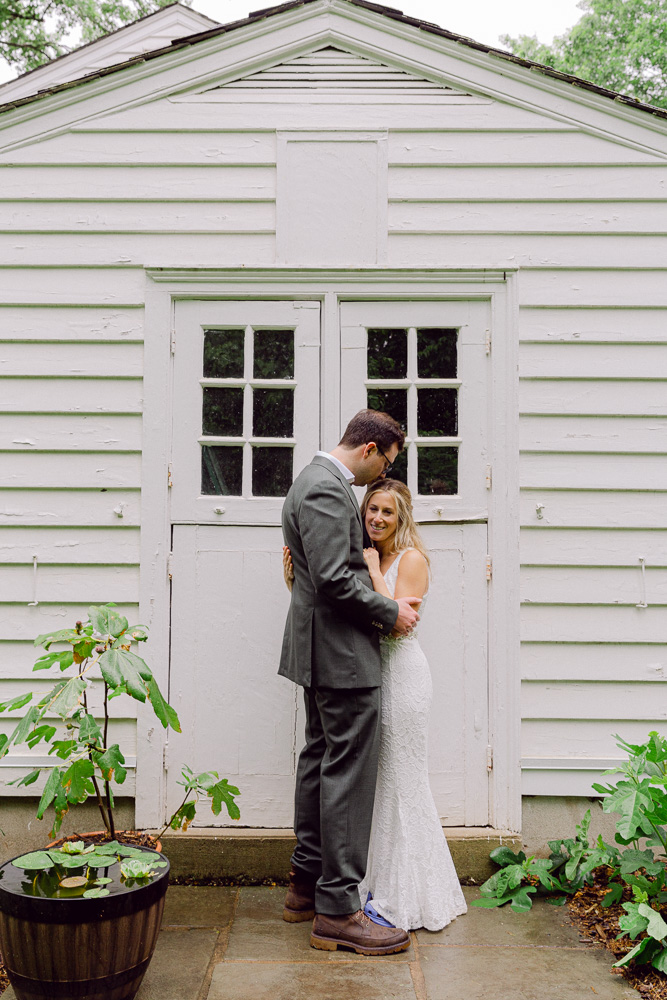 an elegant bride and groom embracing at Mountain Lakes House in Princeton, NJ by Laura Billingham Photography