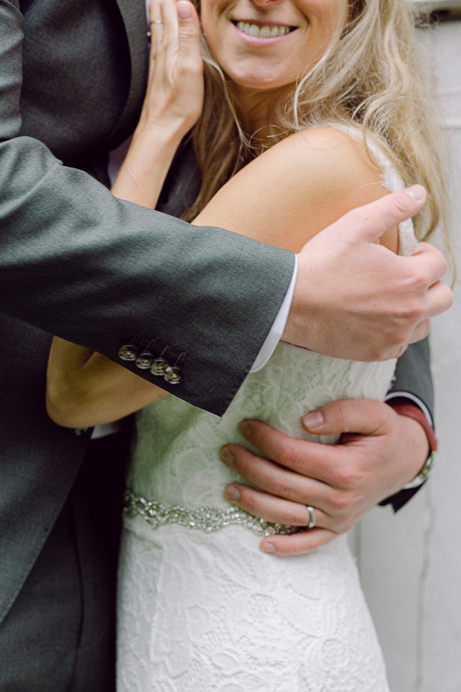 Detail of an elegant bride and groom embracing at Mountain Lakes House in Princeton, NJ by Laura Billingham Photography