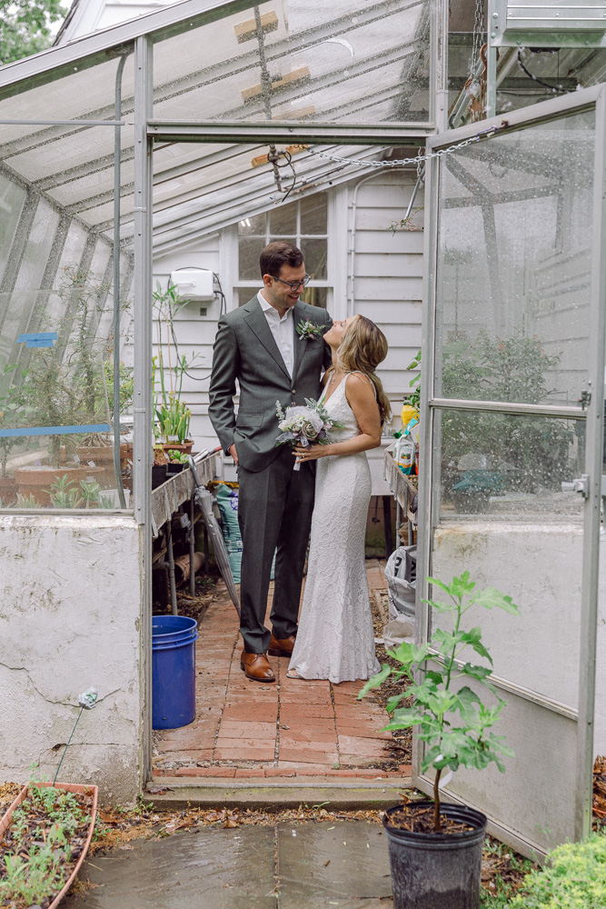 bride and groom in the greenhouse at Mountain Lakes House by Laura Billingham Photography