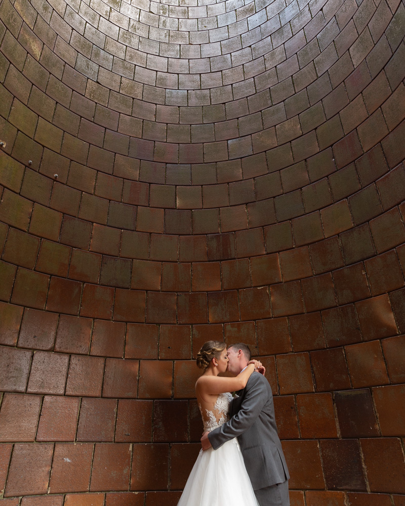 Bride and groom kiss in the historic silo at the Coach House at the Ryland Inn in Whitehouse Station, NJ by Laura Billingham Photography