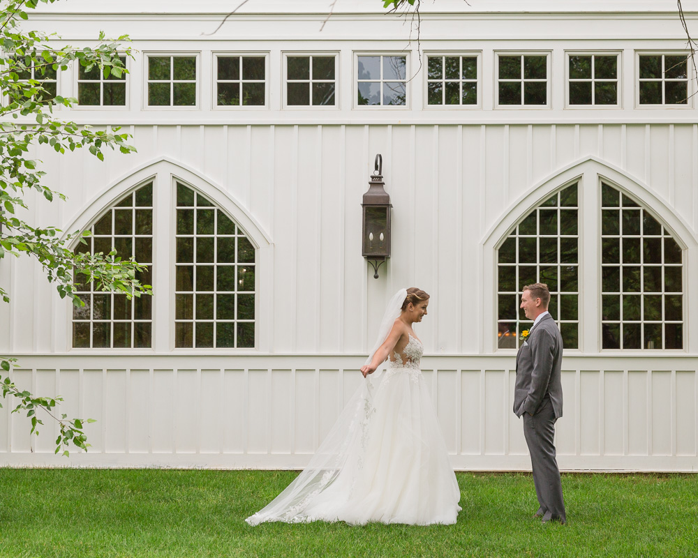 Elegant bride and groom share a first look at the Coach House at the Ryland Inn in Whitehouse Station, NJ by Laura Billingham Photography