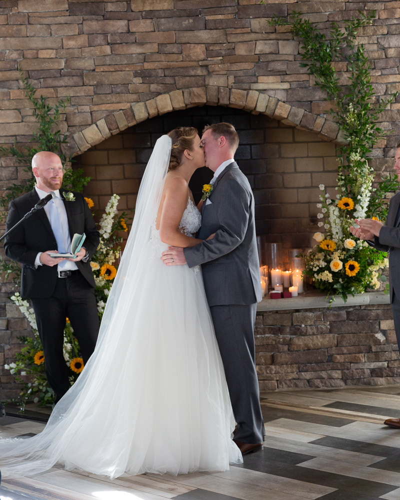 Elegant bride and groom kiss after their wedding ceremony at the Coach House at the Ryland Inn in Whitehouse Station, NJ by Laura Billingham Photography