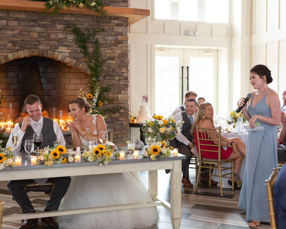 Bridesmaid toast during an elegant wedding at the Coach House at the Ryland Inn in Whitehouse Station, NJ by Laura Billingham Photography