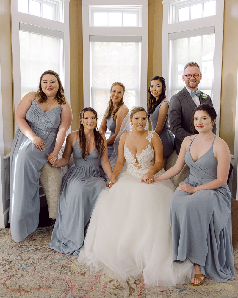 Elegant bride holds hands with her attendants before her wedding ceremony at the Ryland Inn in Whitehouse Station, NJ by Laura Billingham Photography
