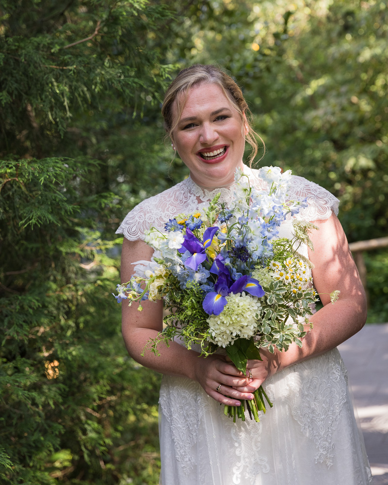 Smiling bride with big bouquet at HollyHedge Estate by Laura Billingham Photography