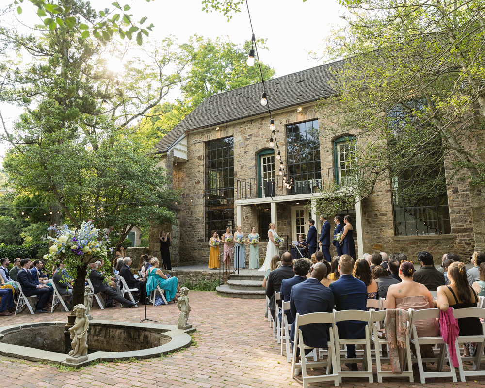 Elegant wedding ceremony in front of Old Barn at HollyHedge Estate in New Hope, PA