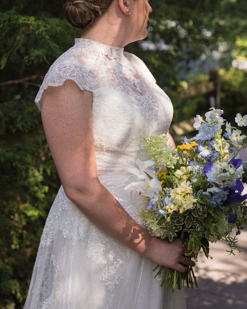 Detail of bride with big bouquet at HollyHedge Estate by Laura Billingham Photography