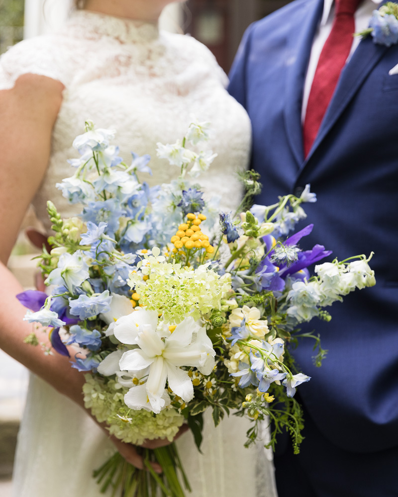 Detail of elegant bridal bouquet with bride and groom at HollyHedge Estate in New Hope, PA