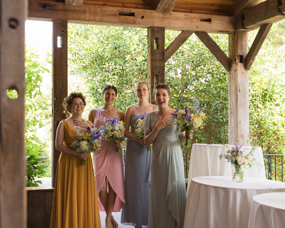 Bridesmaids smile upon seeing bride at HollyHedge Estate by Laura Billingham Photography