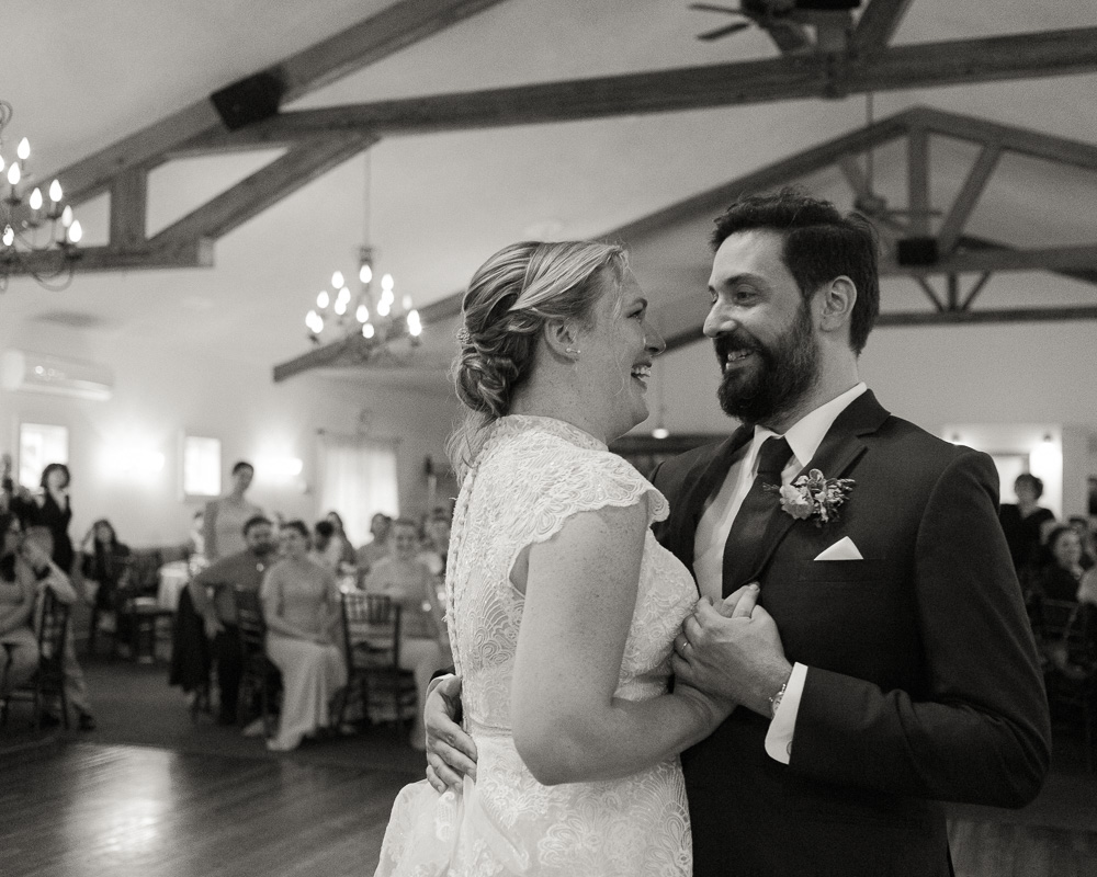 black and white photo of elegant bride and groom during their first dance at HollyHedge Estate in New Hope, PA