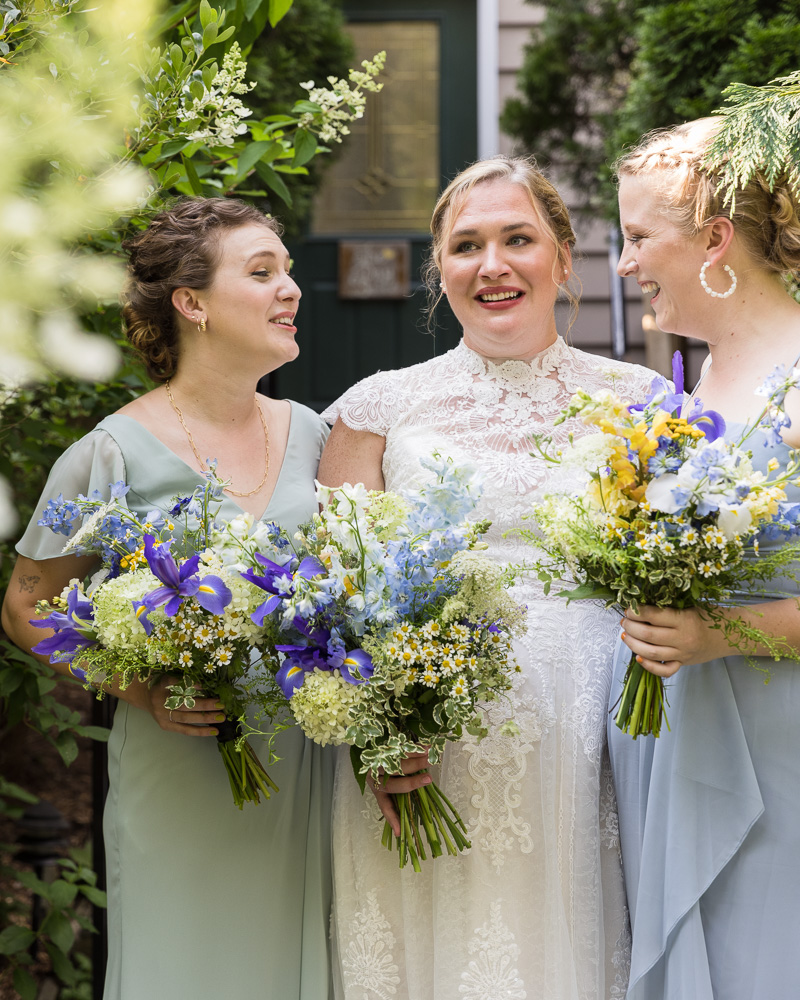 Smiling bride with bridesmaids at HollyHedge Estate by Laura Billingham Photography
